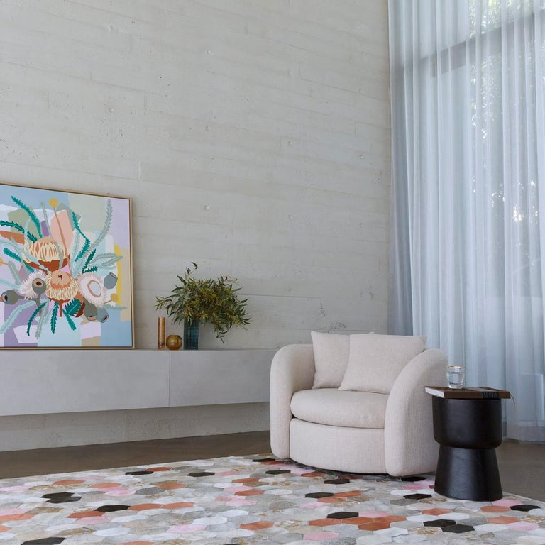 The retro, science fiction inspired hornet features bold pops of vibrant color with luxe gold detailing.  Playful yet evocative, the hornet takes its cues from the rich colors of the desert and fun poolside style.  Art Hide cowhide rugs are