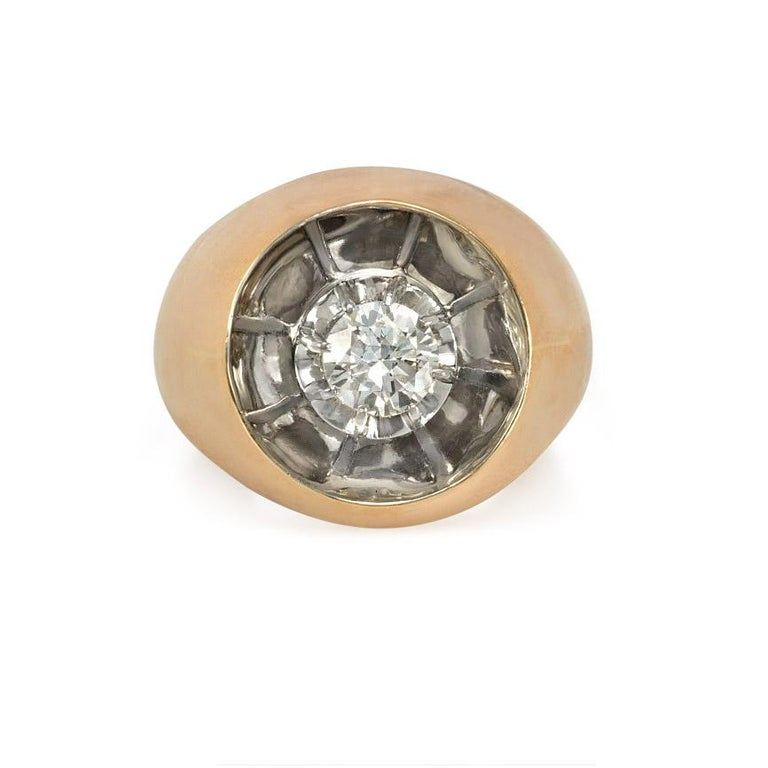 A Retro ring in the Art Moderne style, comprising a floating prong-set modern brilliant cut diamond in a reflective, concave setting, in 18k gold and platinum.  French import marks.  Atw of diamond 0.73 ct.  Current ring size: US 7; please contact