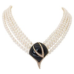 Retro Multi Strand Pearl Necklace with Black Onyx and .38 Carat Diamond Clasp