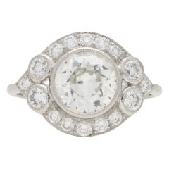 Retro Old Cut Diamond Halo Cluster Engagement Ring Set in Platinum