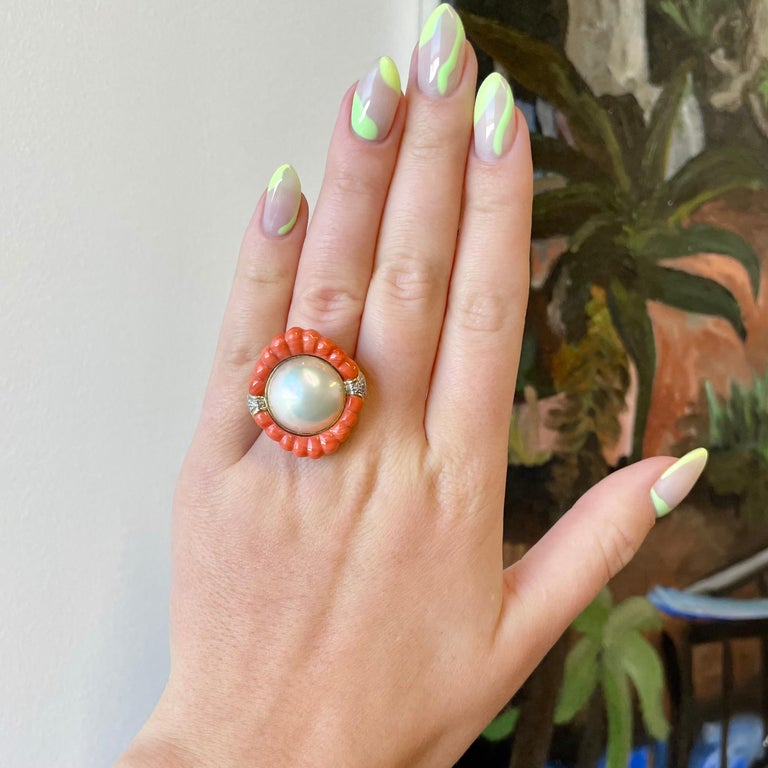 The 1940's are known for its dramatic and charismatic cocktail rings, intriguing dinner parties and Hollywood stars. Be a star wearing this stunning Retro Pearl Coral Diamond 14k Gold Cocktail Ring.   The ring features a pearl, coral and 6 diamonds.