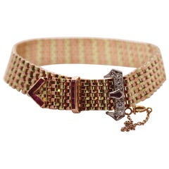 Retro Period Gold and Palladium Buckle Bracelet with Diamonds and Rubies