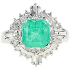 Retro Platinum 1.83 Carat Emerald and Diamond Cocktail Ring