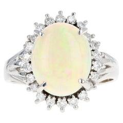Retro Platinum 1.83 Carat Oval Cabochon Cut Opal and Diamond Ring