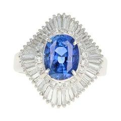 Retro Platinum 2.46 Carat Oval Sapphire and Diamond Cocktail Ring