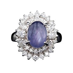 Retro Platinum 2.63 Carat Oval Cabochon Cut Natural Star Sapphire & Diamond