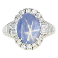 Retro Platinum 6.14 Carat Star Sapphire and Diamond Ring