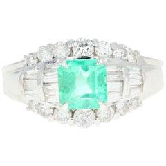Retro Platinum .88 Carat Emerald and Diamond Ring
