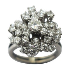 Retro Style Platinum Diamond Ring with Central 0.50ct and 22 O.10 Carat Diamonds