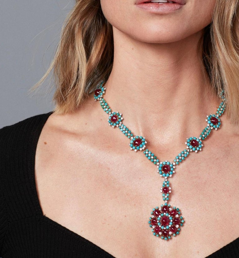A refined retro necklace set throughout with cabochon turquoise highlighted with cabochon cut rubies, further enhanced with brilliant-cut diamonds (app. 4-4.5 cts) , length approximately 430mm; with French assay marks for gold and maker's marks.