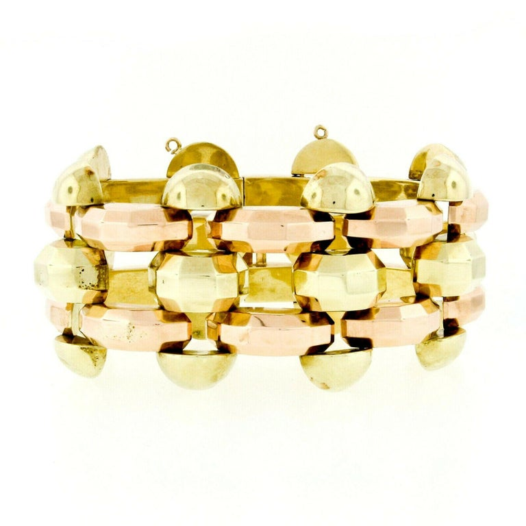 Here we have a very unique-looking vintage bracelet which was crafted from solid 14k rose and green gold during the 1940's. The bracelet features a wide pattern alternating faceted geometric links giving it its unique and fashionable look. It is