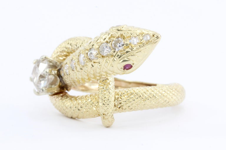 Era: Retro c.1950's  Hallmarks: 14k  Composition: 14K Yellow Gold  Primary Stone: Old European cut diamond  Stone Carat: about 1.08 carats (Slight ship to edge)  Color / Clarity: Champagne colored, I1  Accent Stone: .25 carats of additional