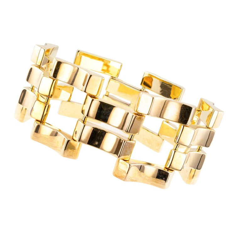 "Retro yellow gold wide link bracelet circa 1950.  DETAILS: METAL:  14-karat yellow gold.  HALLMARKS:  signed Mossalone.  MEASUREMENTS:   approximately 7"" (17.8 cm) long and 1-1/16"" (2.7 cm) wide overall,   37.7 grams.  CONDITION:  high magnification"