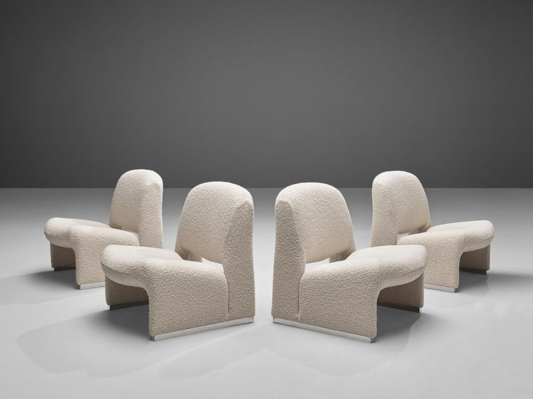 Lounge chairs, fabric, metal, Italy, 1970s  These lounge chairs strongly remind of Giancarlo Piretti's 'Alky' lounge chair (1969), yet they feature characteristic differences. Whereas the 'Alky' lounge chair consists of one shell, these chairs have