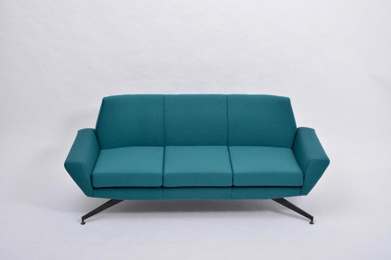 Reupholstered Italian Mid-Century Modern sofa with metal base by Lenzi  This three-seat sofa was produced by Italian company Lenzi in the 1950s. The base is made of lacquered metal. The sofa has been completely reupholstered in a teal colored