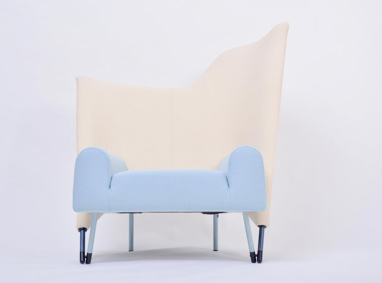 Reupholstered Torso Lounge Chair Designed by Paolo Deganello The Torso lounge chair was designed by Paolo Deganello in 1982 and was produced for Cassina. With its' asymmetric and sculptural backrest and two color scheme it is a true statement