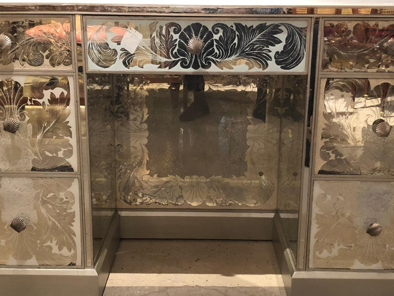 A reverse paint decorated Hollywood Regency desk or vanity from the vintage deco era. This stunning vintage desk comes from part of a vast collection of mirrored and glass merchandise fresh from a Greenwich CT mansion of a Gentleman. This foil