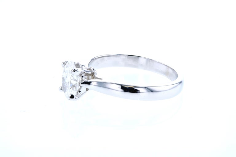 This reverse tapered engagement ring has a built-in (raised, cathedral) style setting and can be made in any color gold or platinum and customized for any shape center diamond.  Each piece we make is customized to our client's specifications.