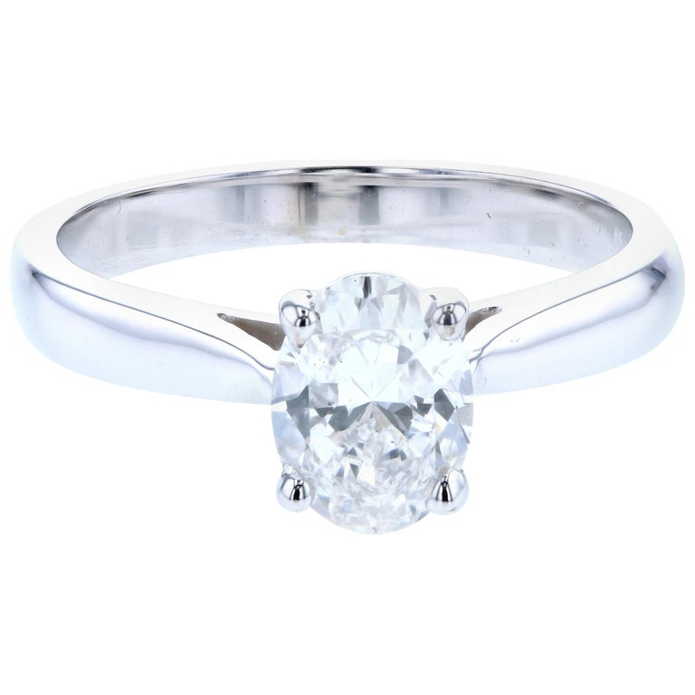 Reverse Taper Oval Diamond Solitaire Engagement Ring For Sale