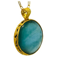 Celeste Reversible Aqua and Mother of Pearl Pendant in 22k Gold, by Tagili