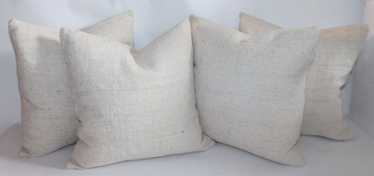 19th century homespun linen pillows that are reversible and down & feather fill. Sold as a group of four pillows These pillows are so organic and natural woven fabric.