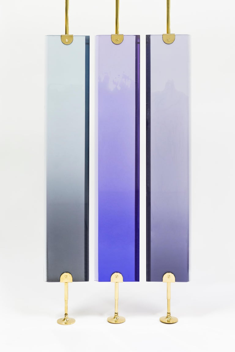 Dialoghi Mimetici collection by Draga&Aurel:  Partition screen made from cast resin and self standing structure in polished brass. Transparency of the resin creates light effects and color nuances. Handcrafted in our Atelier in Como. Each piece is