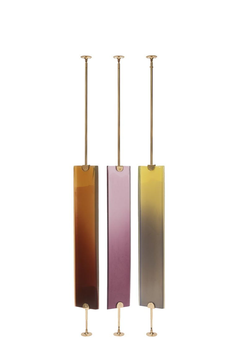 Transparency Matters collection by Draga&Aurel:  Partition screen made from cast resin and selfstanding structure in polished brass. Transparency of the resin creates light effects and color nuances. Handcrafted in our Atelier in Como. Each piece is