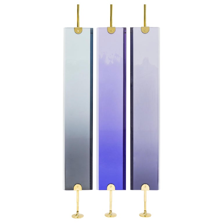 Dialoghi mimetici collection by Draga&Aurel:  Partition screen made from cast resin and selfstanding structure in polished brass. Transparency of the resin creates light effects and color nuances. Handcrafted in our Atelier in Como. Each piece is