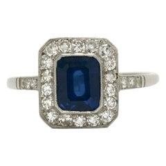 Revivalist Art Deco Sapphire Engagement Ring Emerald Cut Gemstone Diamond Halo