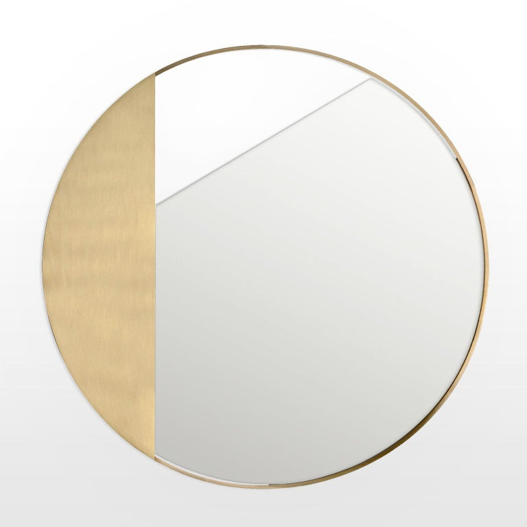 Mirror, 90 cm diameter, with a clean and rigorous design consisting of a brass frame and a cut round mirror. The result is a light balance between frames, mirrors, and walls. You can choose a normal, bronzed, or fumè mirror.  Every piece