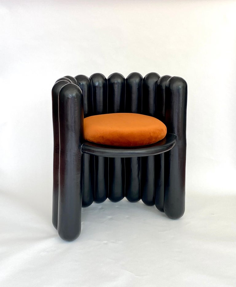 Handmade ceramic statement chair with upholstered velvet seat. The suspended seat is a hallmark of the makers obsession with defying gravity in a medium that works best in compression. *Custom glazing, upholstery or COM available.