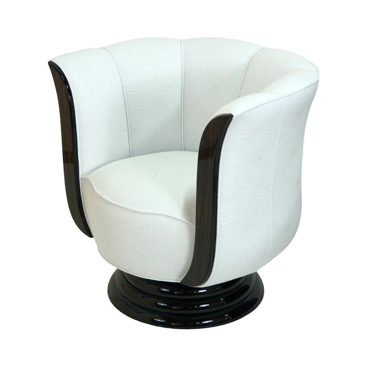 Typical tulip shaped Art Deco style club chair on a round, revolving base. Excellent seating comfort with high quality upholstery.  Handmade in Germany.   Lacquered wood. Black lacquered base. Upholstery with spiral pattern.  Different