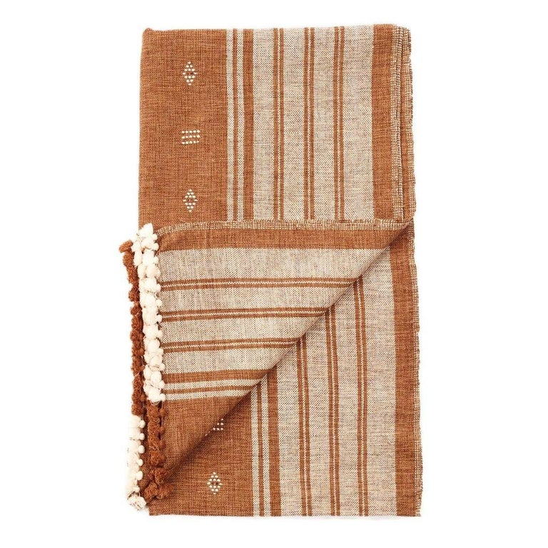 Custom design by Studio Variously, REYTI is a organic cotton throw / blanket handwoven by master weavers in India.  A sustainable design brand based out of Michigan, Studio Variously exclusively collaborates with artisan communities to restore and