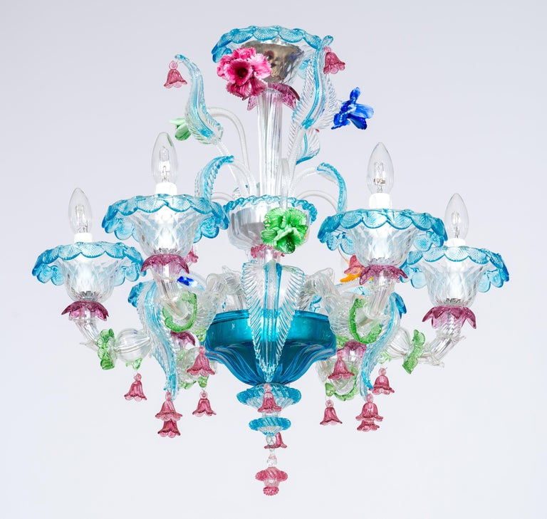 Rezzonico chandelier with Murano glass and glass paste flowers, Italy. This chandelier is an outstanding example of the best Murano glass art. A garden of leaves and flowers spread out from two cups positioned at different heights. The leaves are