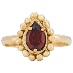 Rhea Ring with Garnet, 18 Karat Yellow Gold