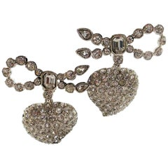 Rhinestone ear clips in the shape of hearts signed by Yves St. Laurent 80's