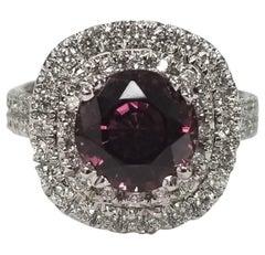 Rhodolite Garnet and Diamond Ring Set in 14 Karat Double Halo