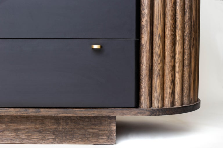 Designed to be noticed and built to last for generations. The ribbed credenza's strong lines and bold structure are borrowed from the architecture of the Brutalist movement. Solid hardwoods and thick leather veneer wrap this piece in luxury.