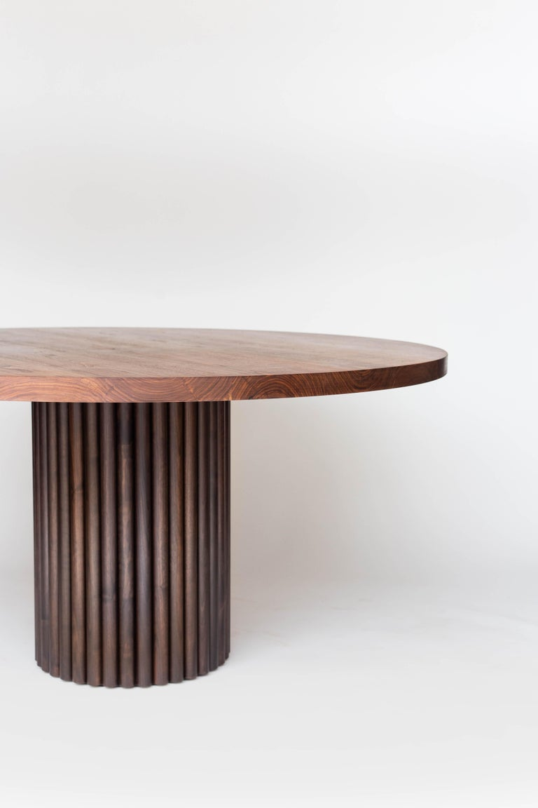 Unapologetically bold, the ribbed dining table is a statement piece that pays homage to both a contemporary aesthetic as well as ancient architecture. A column of coopered ribs and a hefty solid wood top creates a table you just can't miss. Expertly