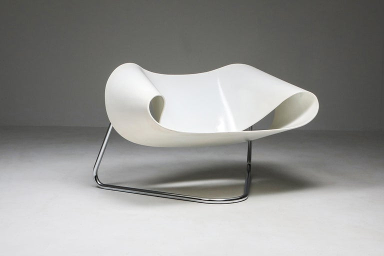 Franca Stagi, CL9 ribbon chair, white, Bernini, Italy, circa 1961   Moulded fibreglass seating section on chrome tubular base.   Gorgeous high-end piece by a female designer, in original condition.  The ribbon is a symbol of awareness and