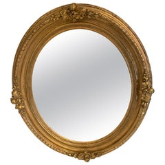 Rich Italian Carved Giltwood Oval Mirror