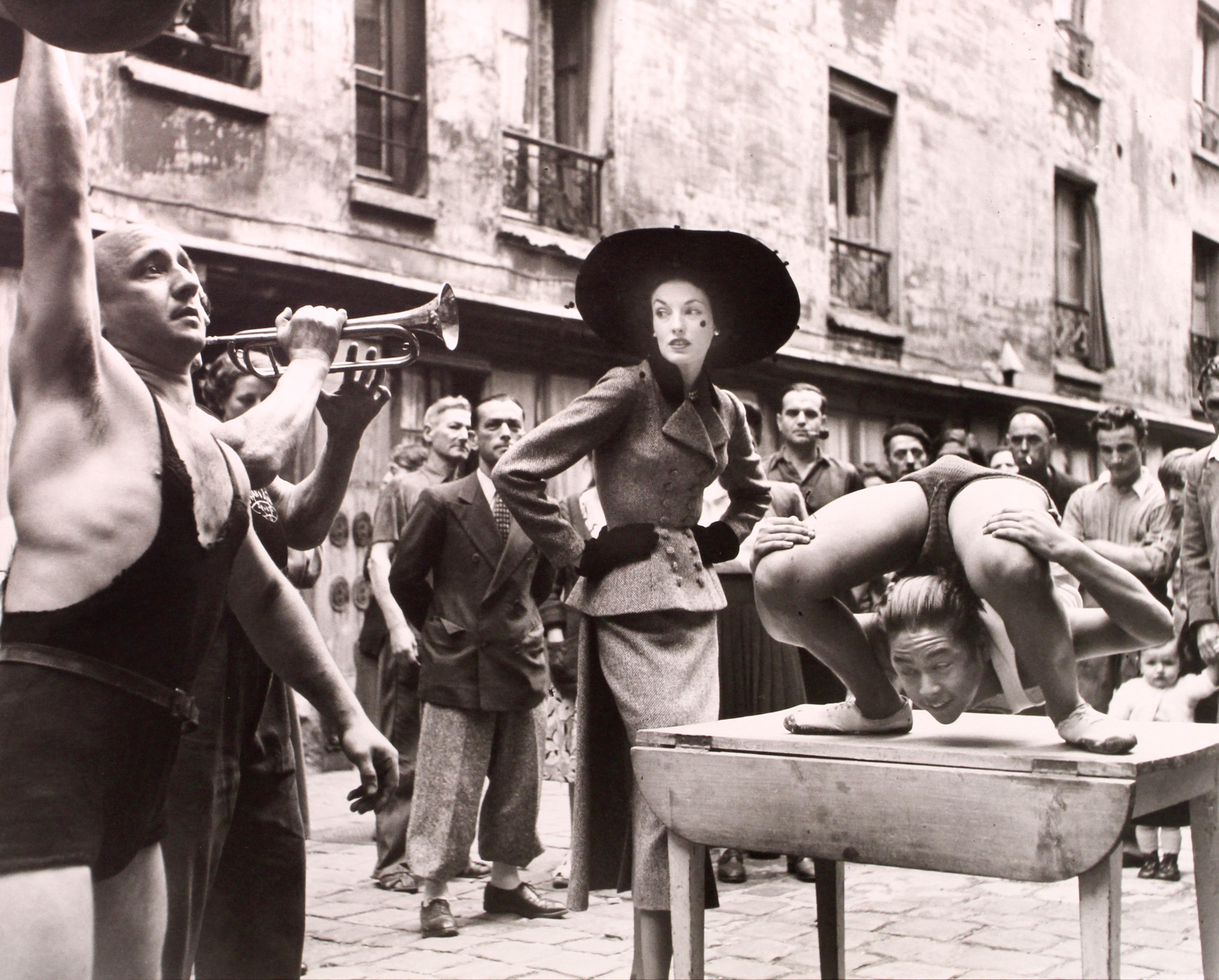 Elise Daniels with Street Performers, Suit by Balenciaga, Le Marais, Paris, Augu