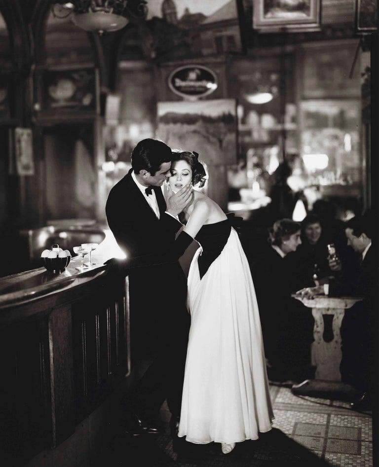 Richard Avedon Figurative Photograph - Suzy Parker & Gardner McKay, Dress by Balmain, Café des Beaux-Arts, Paris, 1956
