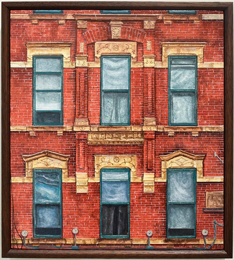 Photo-realist oil painting of classic red brick building exterior in New York City  Oil on linen mounted on panel in a handmade walnut frame 11.25 x 10 x 2 inches framed Wire backing for seamless hanging  This contemporary, realistic oil painting of