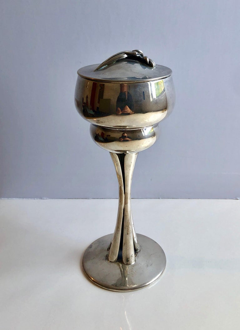 Richard Fishman, b. 1941, American, (RISD BFA 1963, Sculpture) A large sterling silver with interior gilding Kiddush cup, lidded goblet by RICHARD FISHMAN for EDITIONS JUDAICA. United States, c. 1970s. On solid round base with stylized stem that