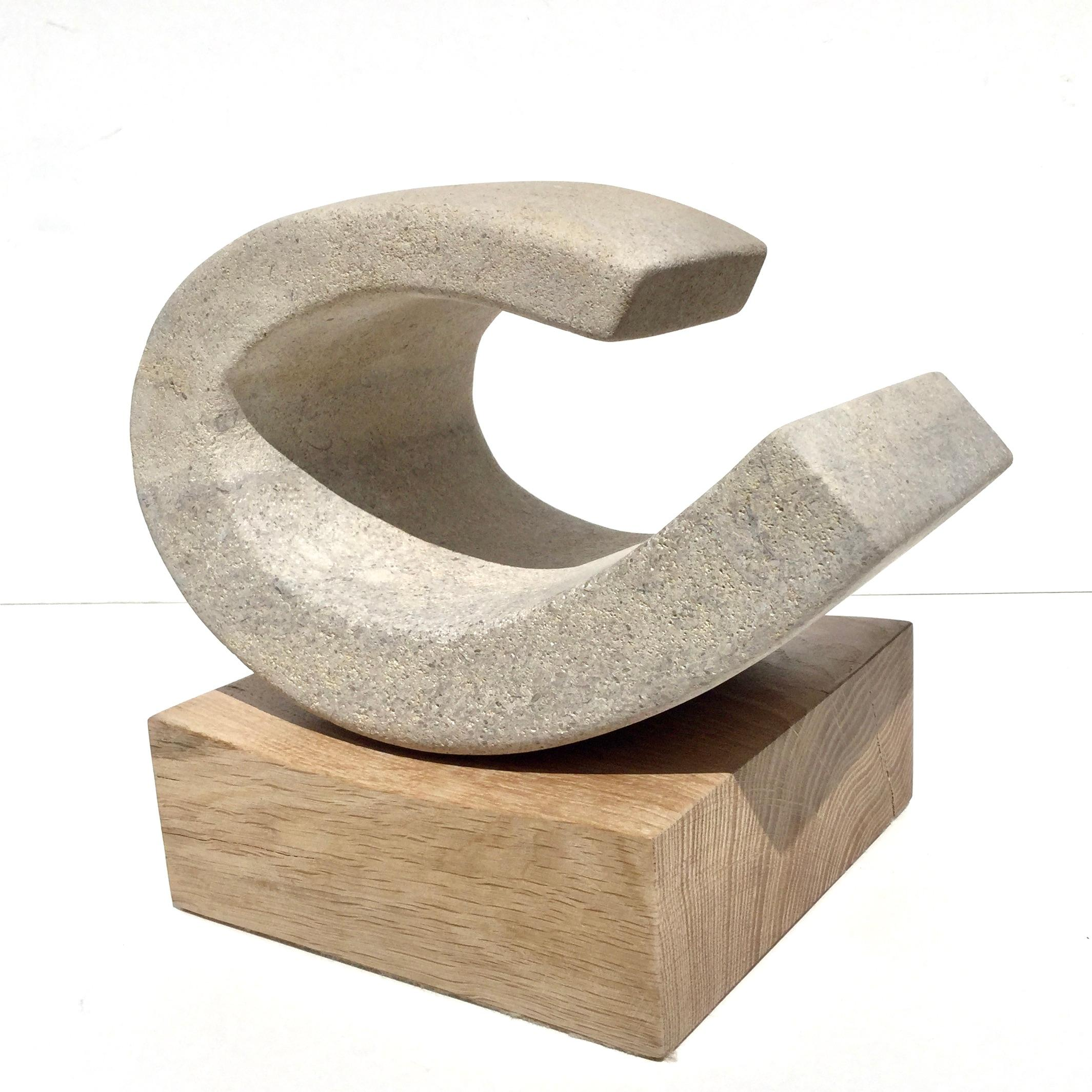 Wave II, 2020, Richard Fox. abstract stone sculpture on oak plinth, carved