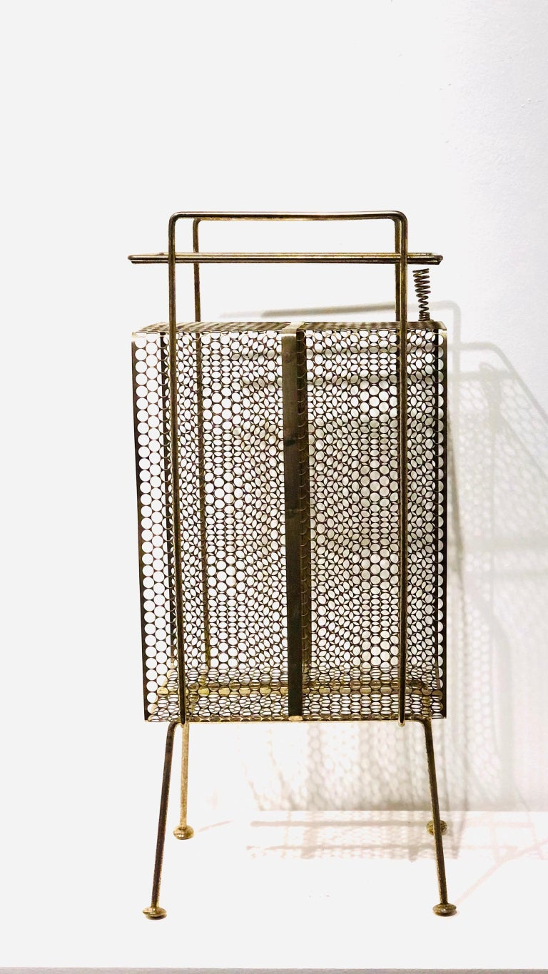 The 1950s Classic midcentury, atomic age era Stand/rack original used for the telephone, pen holder and phone directory, this one its in brass finish with some wear and patina due to age. Designed by Richard Galef for Ravenware.