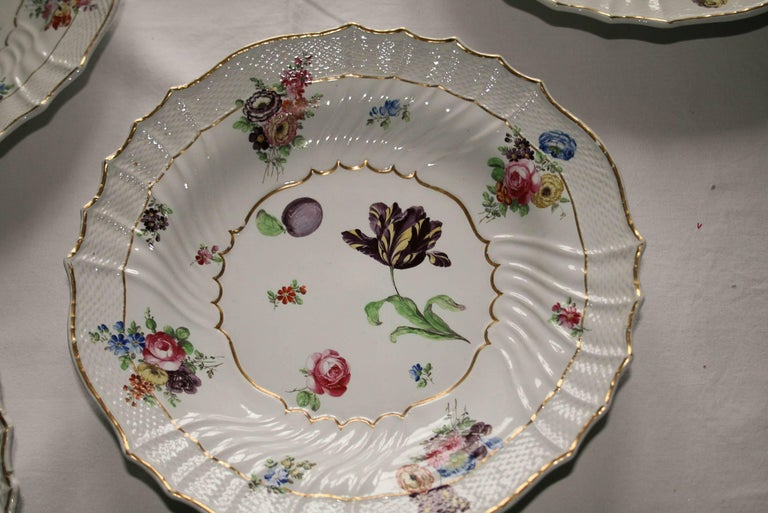 The set of eight hand-painted flower design porcelain dishes was manufactured by Richard Ginori in the historical headquarter of Doccia (Tuscany, Italy), one of the most important and famous producer in the Europe of 18th Century and today