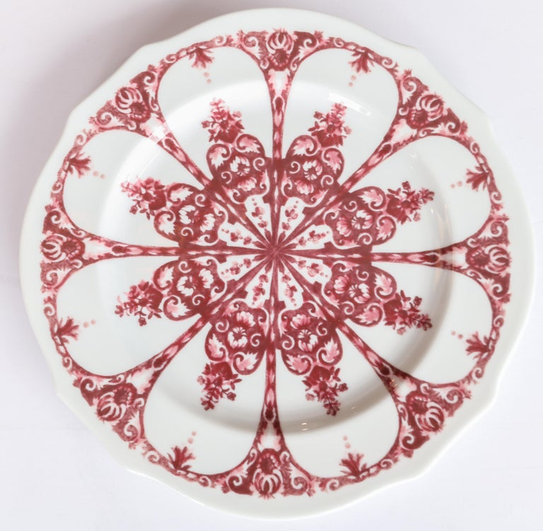 Richard Ginori Babele Rosso red flat dessert plate in the Duchessa shape 22cm in diameter.