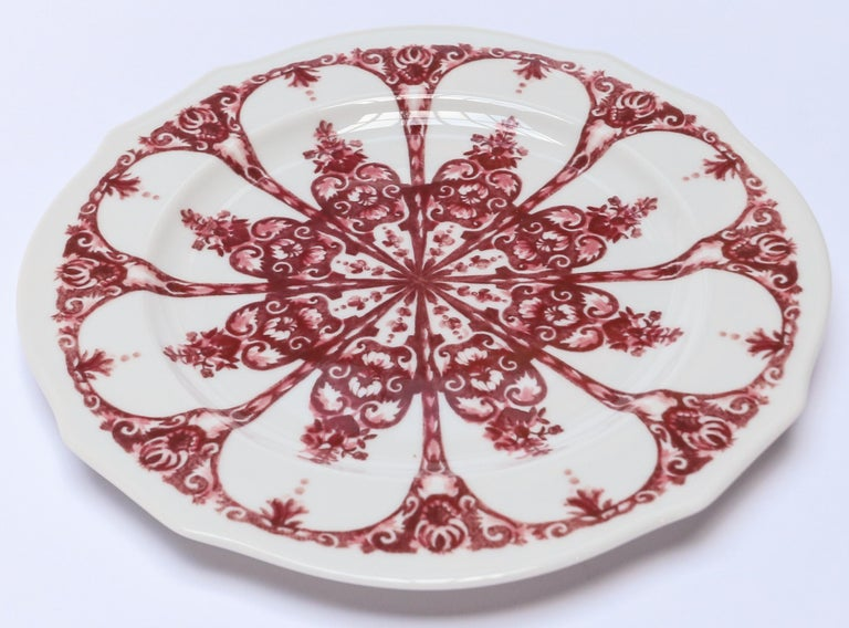Richard Ginori Babele Rosso red flat dinner plate in the Duchessa shape 28cm in diameter.